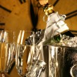 Champagne in bucket with glasses ready for New Years — Lizenzfreies Foto