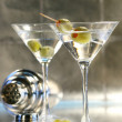 Martinis with green olives on bar counter — Stock Photo #3277928