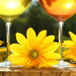 Golden wine in the sun on a rustic table — Stock Photo