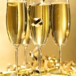 Stock Photo: Glasses of golden champagne ready to party