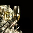 Silver party shoe with glasses of champagne on black — Stock Photo