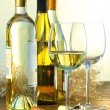 Stock Photo: Bottles of white wine with glasses ready for wine tasting