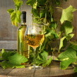 Still life of white wine and grapevine — Stock Photo