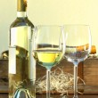 Still life of white wine bottle and glasses with crate in background — Stock Photo #3278179