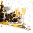 Champagne glasses with festive party hats on white - Stock Photo