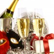 Glasses of champagne with mask and gift - Stock Photo