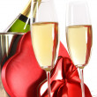 Stock Photo: Champagne glasses with valentine gifts on white