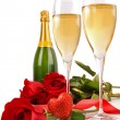 Champagne glasses with roses and little heart — Stock Photo #3278342