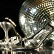 Silver party shoes with champagne glasses - Stock Photo