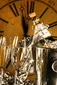 Champagne in bucket with glasses ready for New Years — Stock Photo