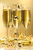 Glasses of golden champagne ready to party — Stock Photo