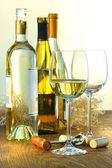Bottles of white wine with glasses ready for wine tasting — Stock Photo