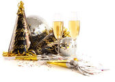 Champagne glasses with festive party hats on white — Stock Photo