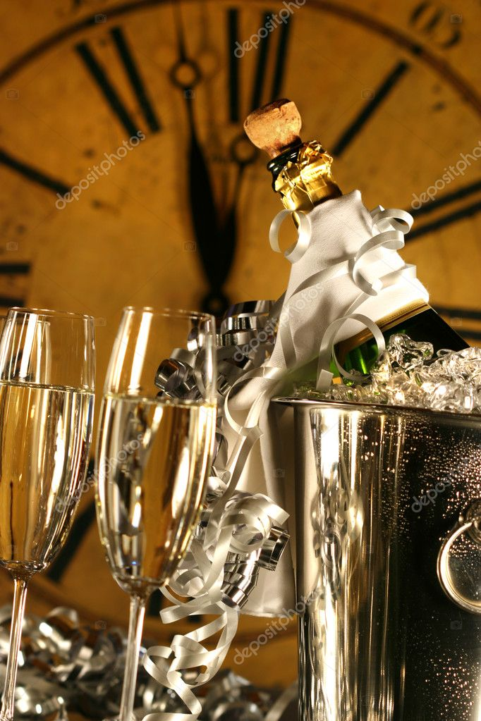Champagne in bucket with glasses ready for New Years festivities  Stock Photo #3277880