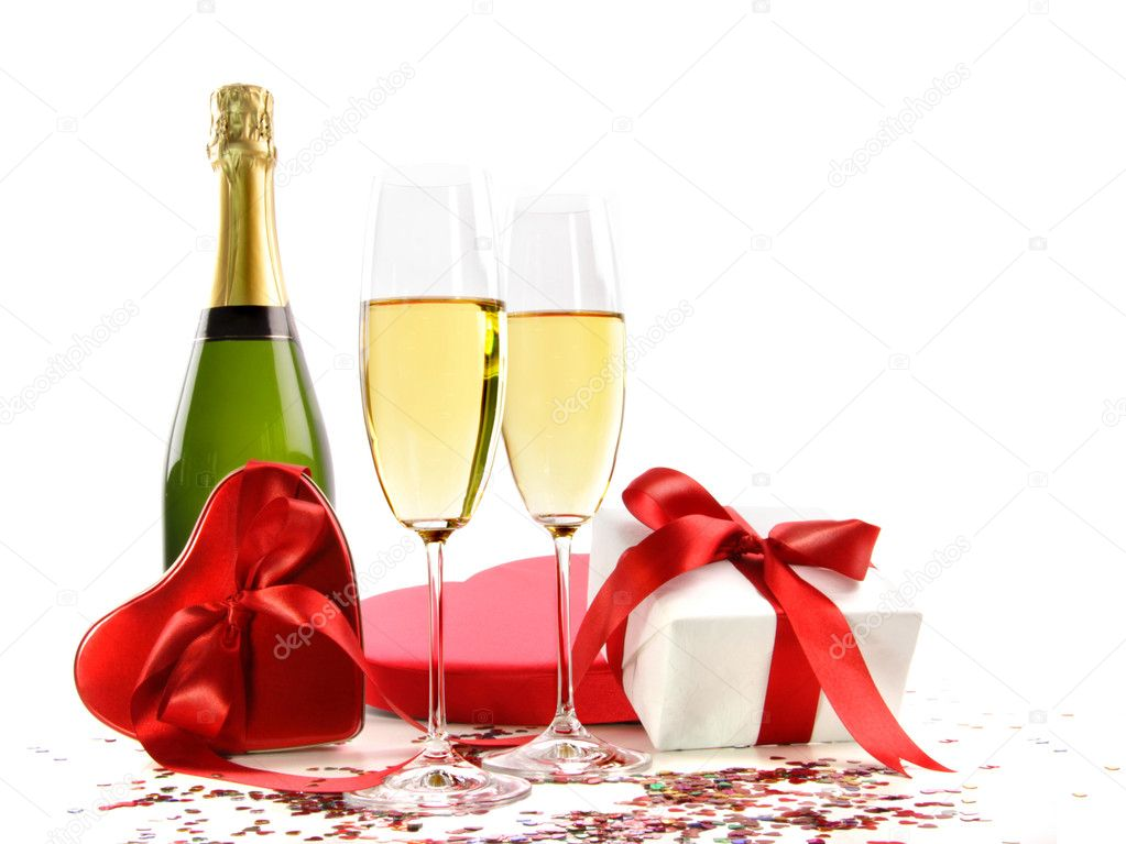 Glasses of champagne with bottle and gifts on white — Stock Photo #3278337