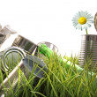 Trash, empty cans and bottles in grass -  