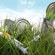 Syringe needles and food cans left in the grass - Stock Photo