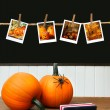 Pumpkins on school desk  in classroom - Stock Photo