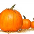 Pumpkins with straw on white — Stock Photo #3293218