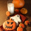 Foto Stock: Halloween cookies with a glass of milk