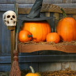 Big pumpkin with black witch hat and broom — Stok fotoğraf