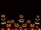 Lots of pumpkins lit brightly — Stock Photo