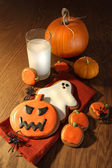 Halloween cookies with a glass of milk — Stock Photo