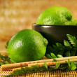 Limes with chopsticks - Stock Photo