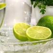 Limes and sparkling water — Stock Photo