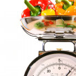 Closeup of kitchen scale with colored peppers - Stock Photo