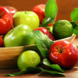 Red and green apples in a bowl - Stock Photo