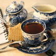 Cup of english breakfast tea with cookies - Stock Photo