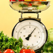 Vegetables on kitchen scale — Stock Photo