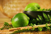 Limes with chopsticks — Stock Photo