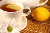Tea and lemon slice — Stock Photo