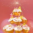 Cupcakes with sparkler on top — Stock Photo