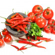 Assortment of red peppers and tomatoes on white — Stock Photo #3319992