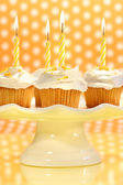 Cupcakes with orange zest sprinkled on top — Stock Photo