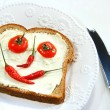 Food arranged into a smiley face on sandwich — Zdjęcie stockowe