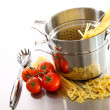 Stock Photo: Cooking pot with uncooked pastand tomatoes