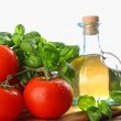 Tomatoes with fresh basil and olive oil — Stock Photo #3320166