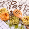 Assortment of colored italian pasta - Stock Photo