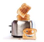 Broodrooster met sneetjes toast — Stockfoto