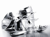 Pile of pots and pans against white — Stockfoto