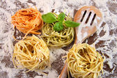 Uncooked italian pasta in three colours — Stock Photo