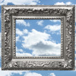 Silver picture frame against a blue sky - Stock Photo