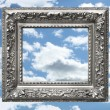 Silver picture frame against a blue sky — Stock Photo #3344005