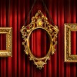 Red drapes with three gold frames - Stock Photo