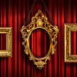 Stock Photo: Red drapes with three gold frames