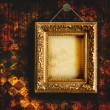 Grungy tattered wallpaper with empty picture frame — Stock Photo